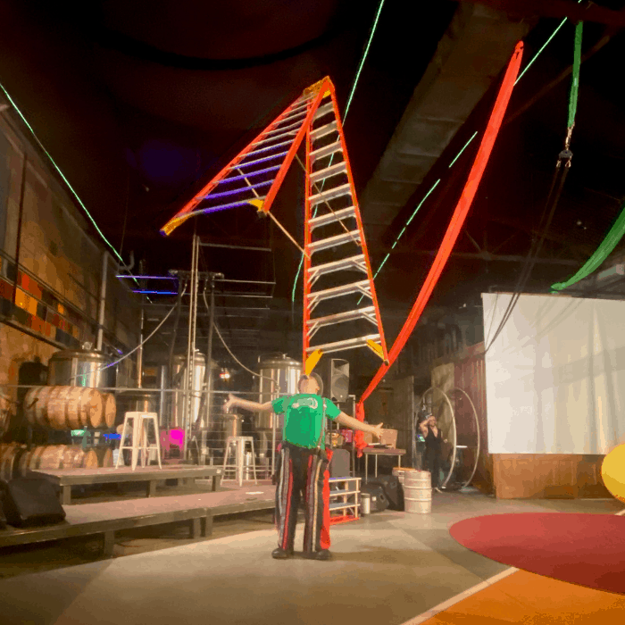 balancing a ladder at Family Matinee Circus and Workshop at Bircus Brewing Company