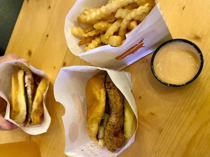 chicken sandwiches and fries at Fifty West Brewing Burger Bar