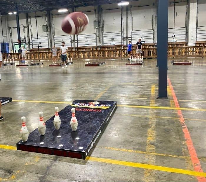 football in the air during a fowling game at Fowling Warehouse Cincinnati
