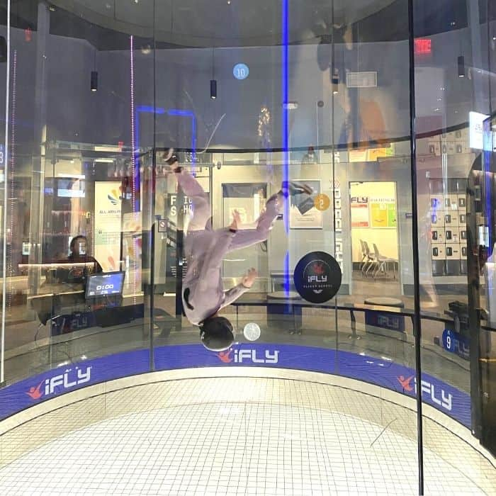instructor doing tricks inside the wind tunnel at iFLY Cincinnati