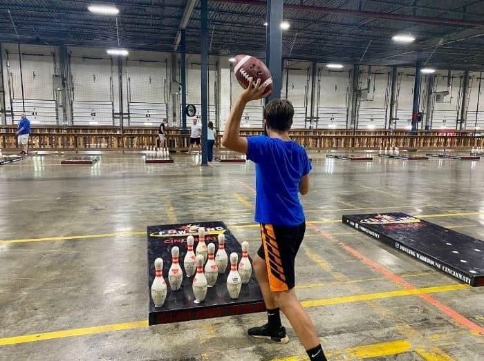 teenage boy playing fowling game at Fowling Warehouse Cincinnati