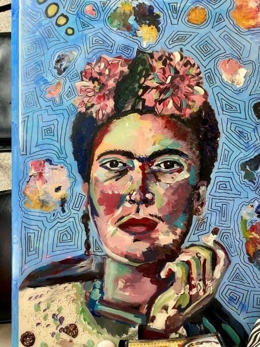 Frida art on a table at Tacos La Bamba