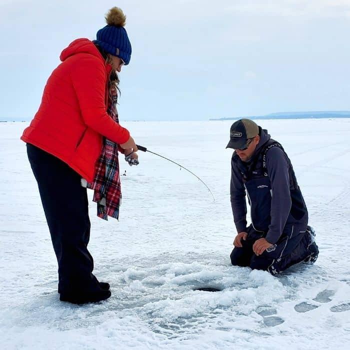 Nedra McDaniel ice fishing on Sturgeon Bay