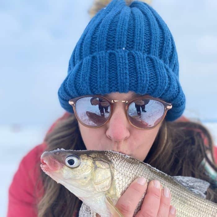 Nedra McDaniel with whitefish from ice fishing