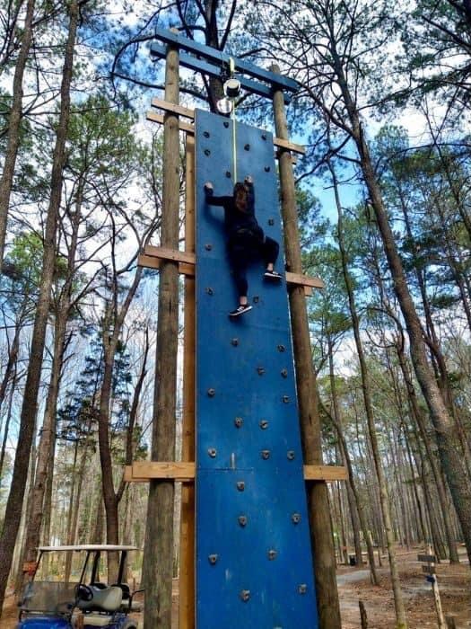 Nedra McDaniel on climbing wall at GoFAR USA Park