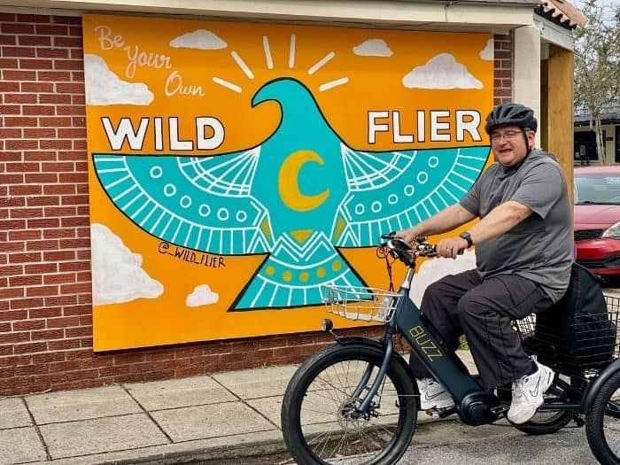 electric trike in front of a mural
