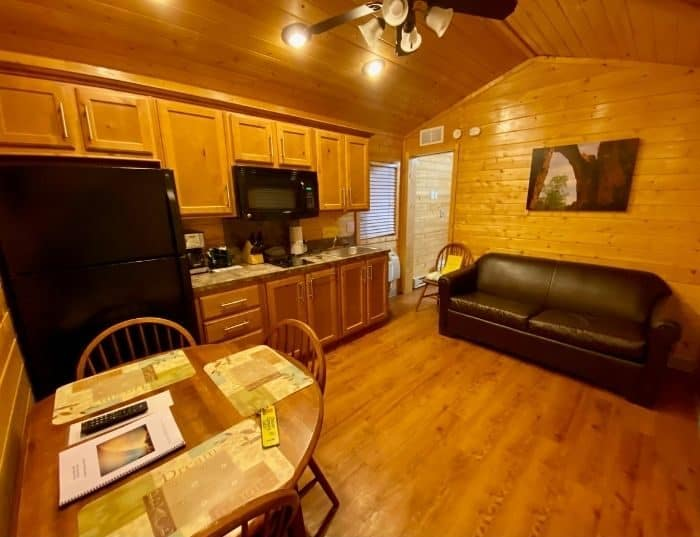 kitchen and family room in the deluxe cabin at night at Cannonville Bryce Canyon KOA