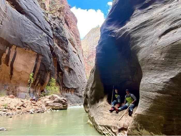 teenagers hiking the Narrows at Zion National Park