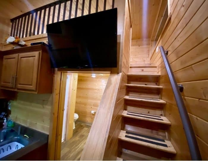 stairs to loft of the deluxe cabin at Flagstaff KOA Holiday