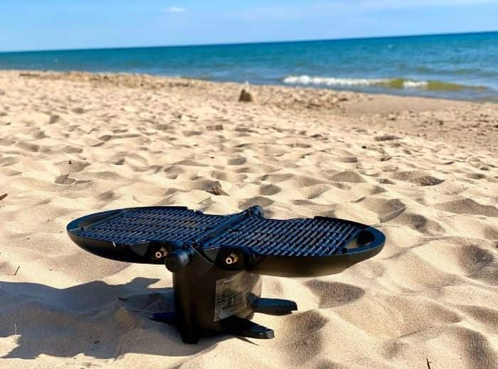 Barbecue on the beach with a portable grill