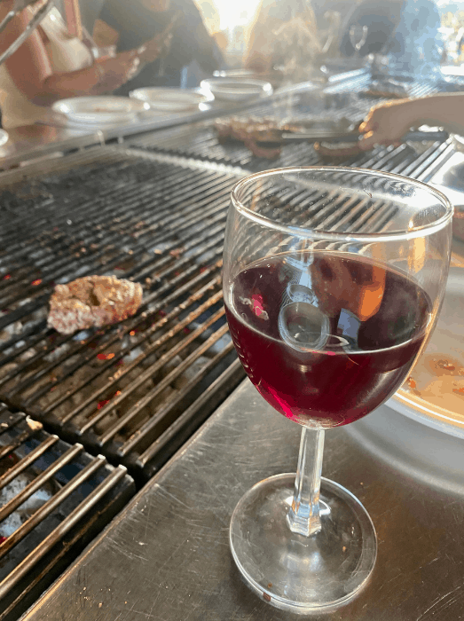 a glass of wine while grilling at Vinoklet Winery