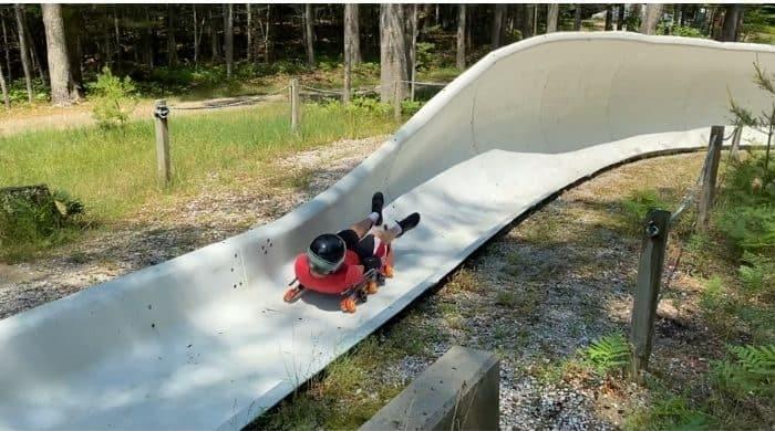 boy on summer wheel luge
