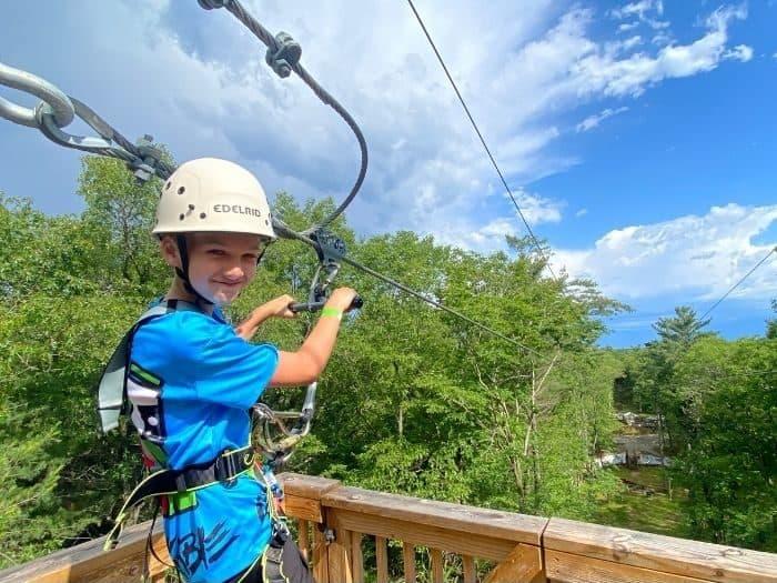 boy on zipline at Muskegon Luge Adventure Sports Park