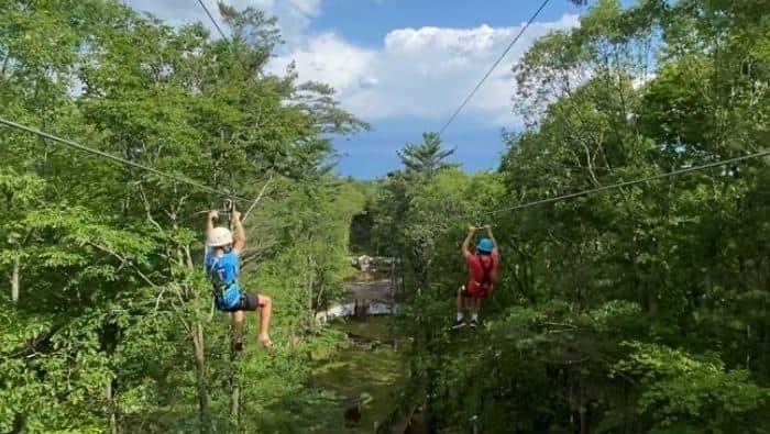 boys dual  ziplining at Muskegon Luge