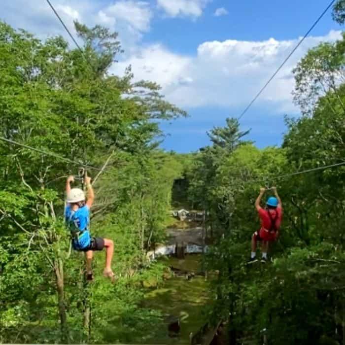boys on dual zipline at Muskegon Luge Adventure Sports Park