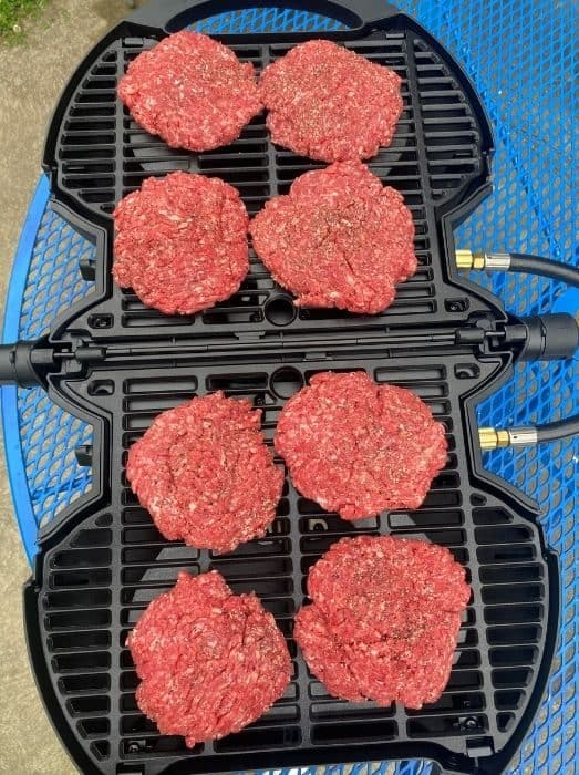 burgers on NomadiQ portable grill on a table