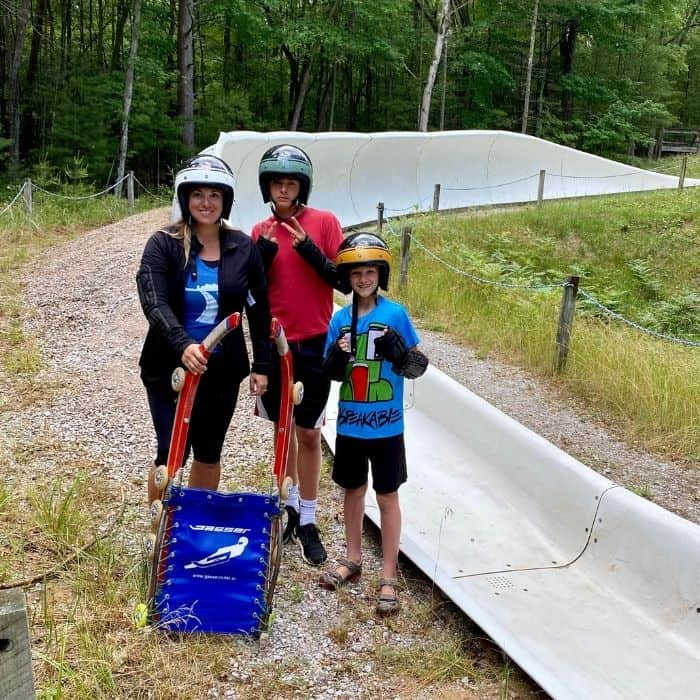 family with next to the summer wheel luge in Muskegon