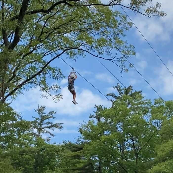 girl ziplining at Muskegon Luge Adventure Sports Park
