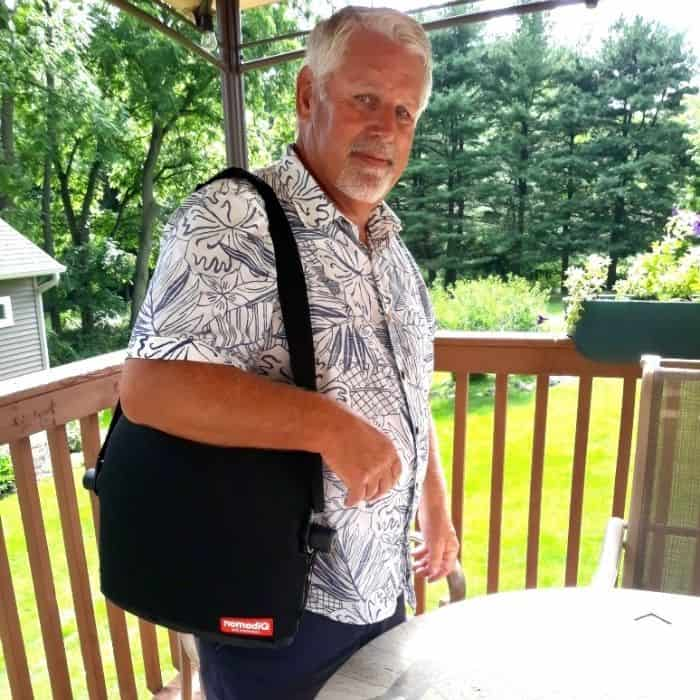 man carrying portable grill