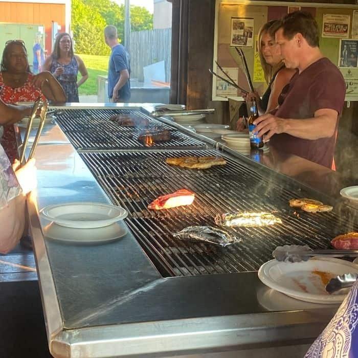 people grilling their dinner at Vinoklet Winery