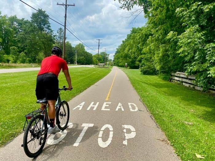 teenager biking on the Little Miami Scenic Trail