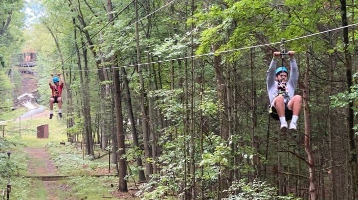 teenagers on dual ziplines at Muskegon Luge Adventure Sports Park