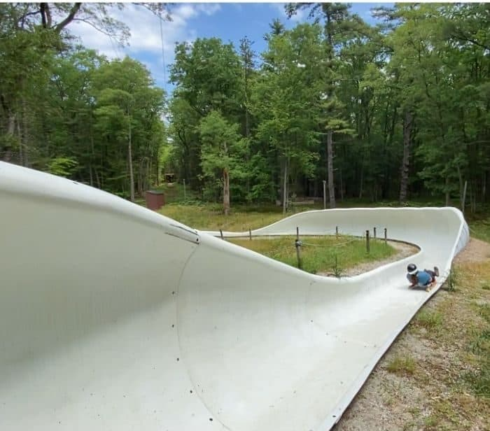 woman on summer wheel luge track in Muskegon