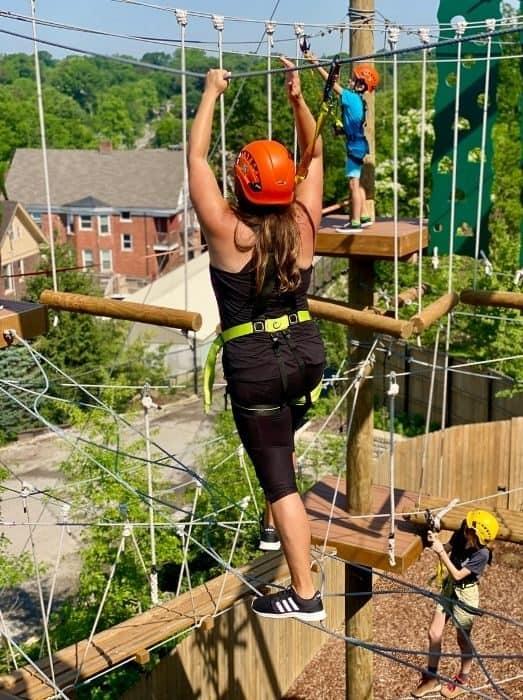 woman on the Kanga Klimb Aerial Adventure Course at Cincinnati Zoo