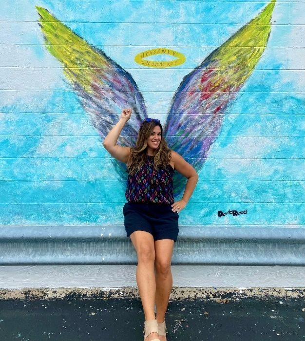 Adventure Mom Nedra McDaniel at Angel Wing Mural on Rebecca Ruth Chocolates Building