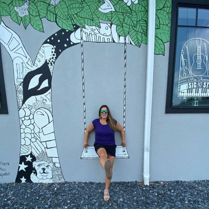 Adventure Mom Nedra McDaniel at Kelsey Montague Mural in Batesville