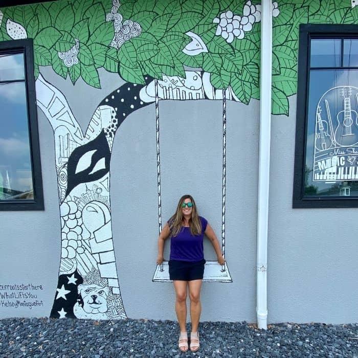 Adventure Mom Nedra McDaniel at Tree & Swing mural by Kelsey Montague