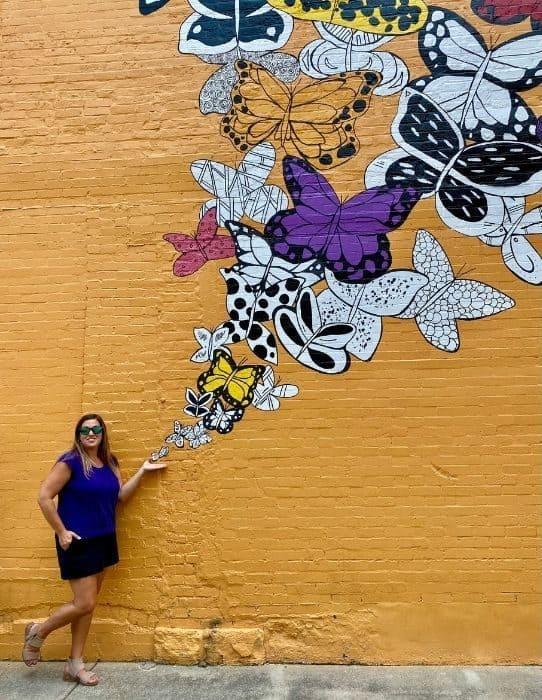 Adventure Mom Nedra McDaniel at butterflies mural by Kelsey Montague in Batesville