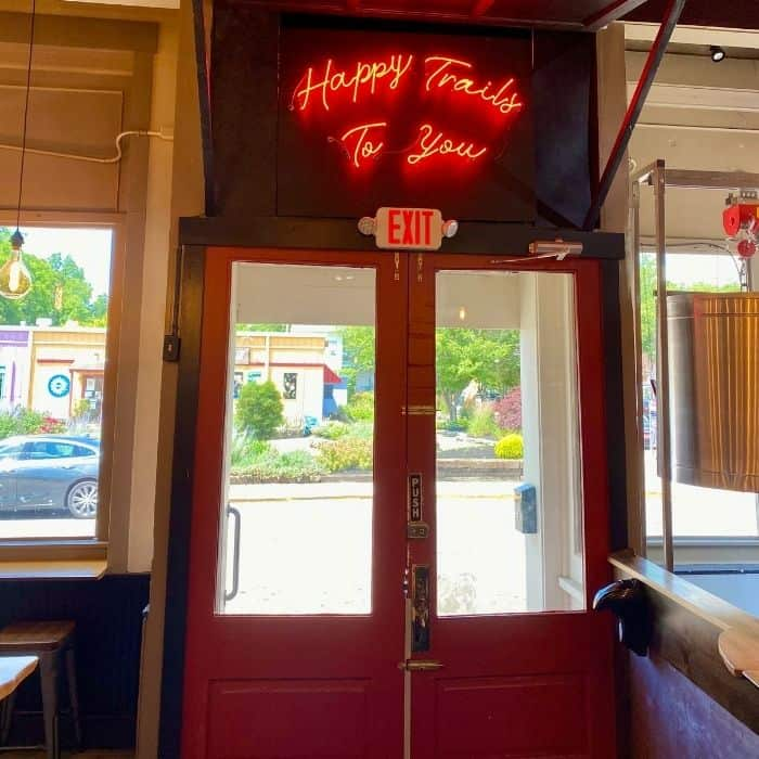 Happy Trails to you neon sign at Trail Town Brewing in Yellow Springs Ohio