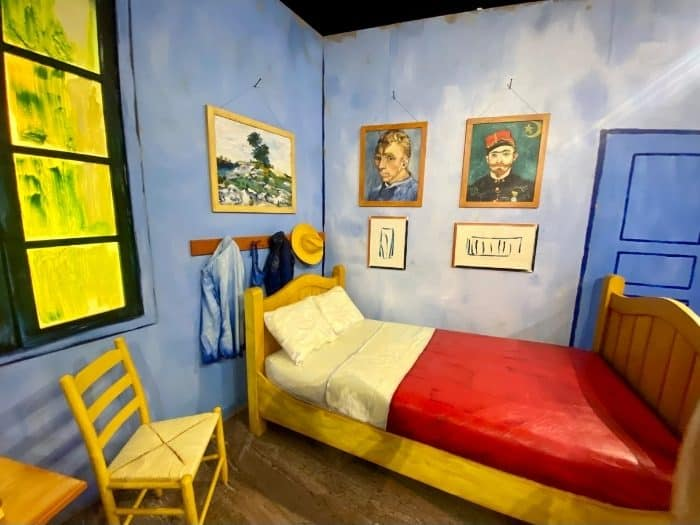 bedroom at THE LUME Indianapolis Van Gogh Experience