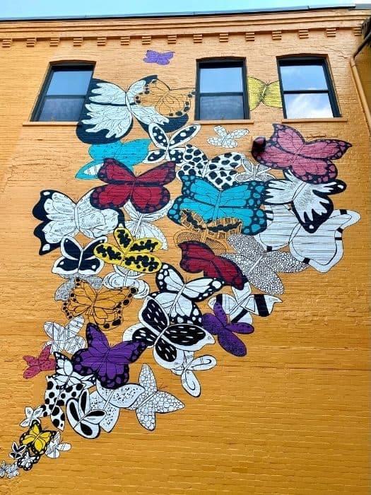 butterflies mural by Kelsey Montague in Batesville
