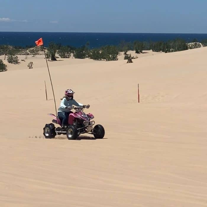 girl on off road vehicle at silver-lake-sand-dunes