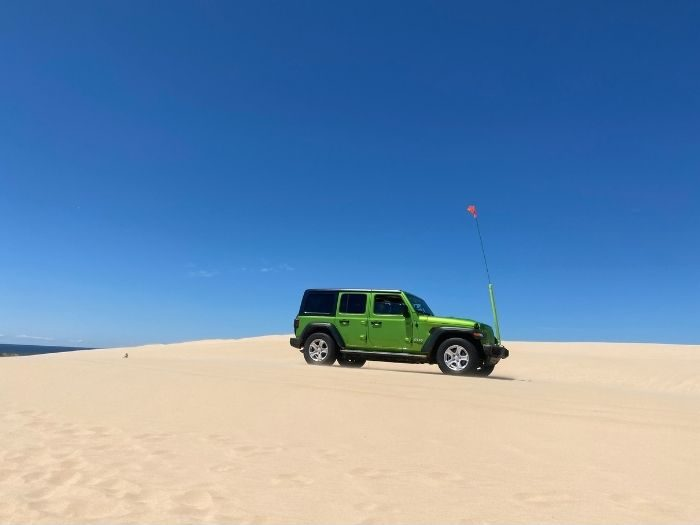 green-jeep-silver-lake-sand-dunes-michigan