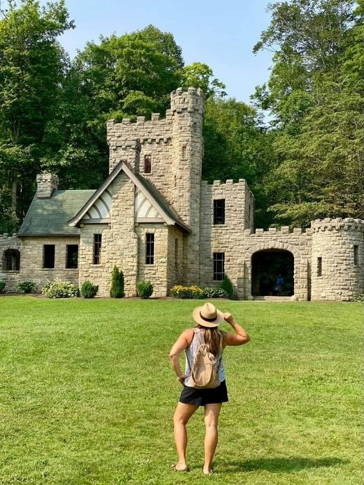 woman in front of Squire's Castle in Ohio