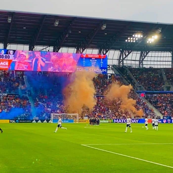 colorful smoke from the bailey section at FC Cincinnati game