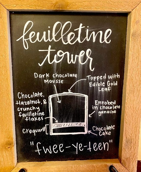 description for Feuilletine Tower at Nicole's Fine Pastry and Ca