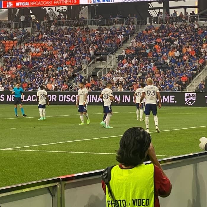 photographer taking pictures at FC Cincinnati match