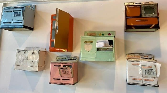 vintage toy ovens on the wall at BernBaum's