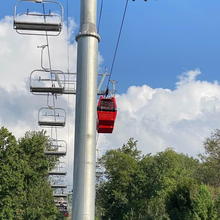 chair lifts and red enclosed gondola cabin
